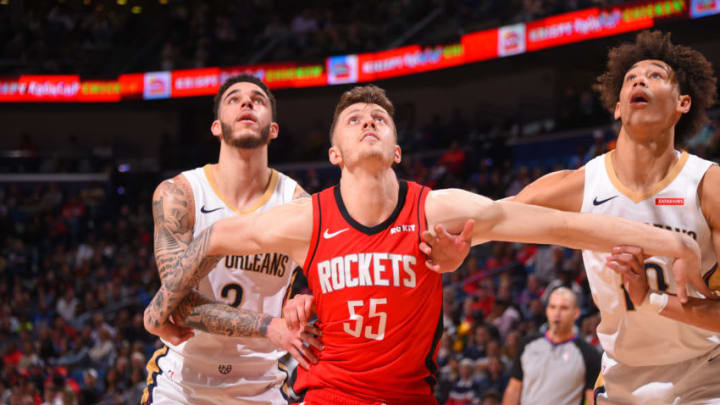 NEW ORLEANS, LA - DECEMBER 29: Isaiah Hartenstein #55 of the Houston Rockets boxes out defenders to grab the rebound against the New Orleans Pelicans on December 29, 2019 at the Smoothie King Center in New Orleans, Louisiana. NOTE TO USER: User expressly acknowledges and agrees that, by downloading and or using this Photograph, user is consenting to the terms and conditions of the Getty Images License Agreement. Mandatory Copyright Notice: Copyright 2019 NBAE (Photo by Bill Baptist/NBAE via Getty Images)