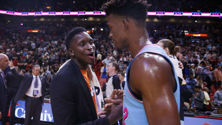 Victor Oladipo #4 of the Indiana Pacers greets Jimmy Butler #22 of the Miami Heat (Photo by Michael Reaves/Getty Images)