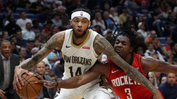 NEW ORLEANS, LOUISIANA - DECEMBER 29: Brandon Ingram #14 of the New Orleans Pelicans fights for the ball with Chris Clemons #3 of the Houston Rockets at Smoothie King Center on December 29, 2019 in New Orleans, Louisiana. NOTE TO USER: User expressly acknowledges and agrees that, by downloading and/or using this photograph, user is consenting to the terms and conditions of the Getty Images License Agreement. (Photo by Chris Graythen/Getty Images)