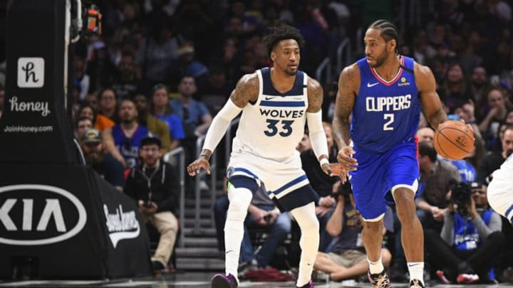 LOS ANGELES, CA - FEBRUARY 01: Los Angeles Clippers Forward Kawhi Leonard (2) is guarded by Minnesota Timberwolves Forward Robert Covington (33) during a NBA game between the Minnesota Timberwolves and the Los Angeles Clippers on February 1, 2020 at STAPLES Center in Los Angeles, CA. (Photo by Brian Rothmuller/Icon Sportswire via Getty Images)