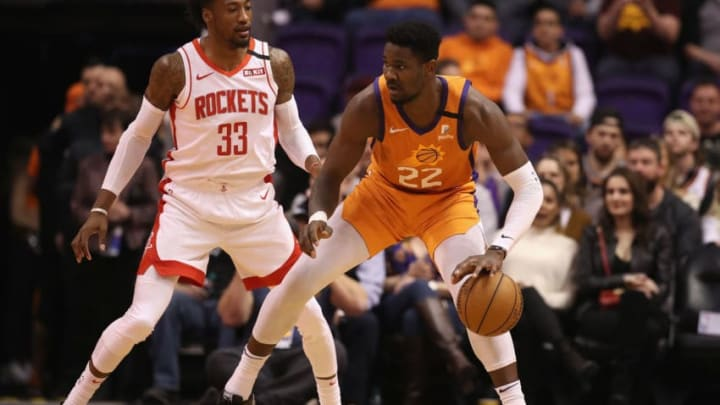 PHOENIX, ARIZONA - FEBRUARY 07: Deandre Ayton #22 of the Phoenix Suns handles the ball against Robert Covington #33 of the Houston Rockets during the first half of the NBA game at Talking Stick Resort Arena on February 07, 2020 in Phoenix, Arizona. NOTE TO USER: User expressly acknowledges and agrees that, by downloading and or using this photograph, user is consenting to the terms and conditions of the Getty Images License Agreement. Mandatory Copyright Notice: Copyright 2020 NBAE. (Photo by Christian Petersen/Getty Images)