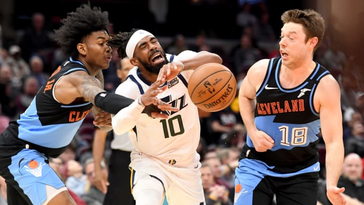 Kevin Porter Jr. #4 and Matthew Dellavedova #18 of the Cleveland Cavaliers (Photo by Jason Miller/Getty Images)