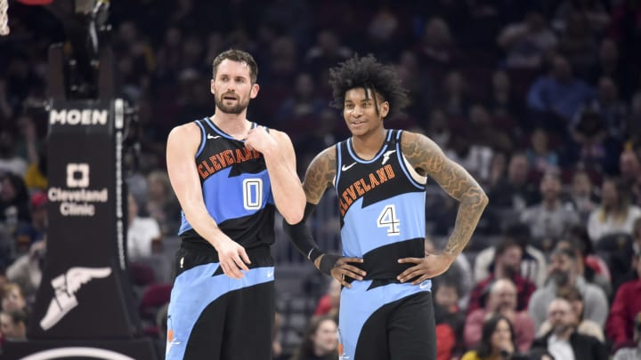Kevin Love #0 talks with Kevin Porter Jr. #4 of the Cleveland Cavaliers (Photo by Jason Miller/Getty Images)