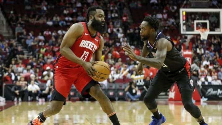 James Harden of the Houston Rockets Patrick Beverley of the LA Clippers (Photo by Tim Warner/Getty Images)