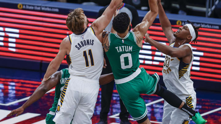 Jayson Tatum #0 of the Boston Celtics, Domantas Sabonis #11 of the Indiana Pacers (Photo by Michael Hickey/Getty Images)
