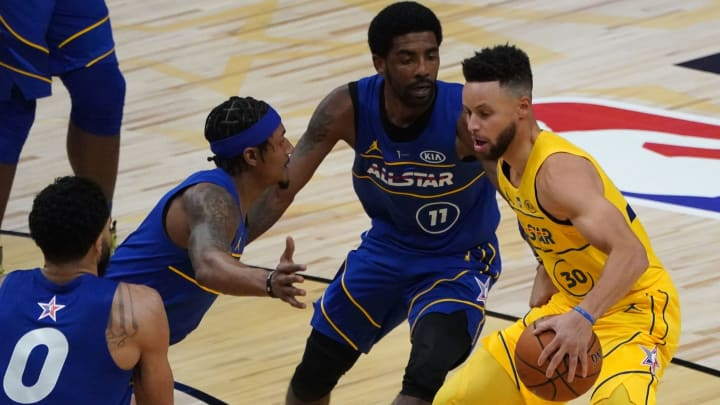 Stephen Curry, Bradley Beal, Kyrie Irving (Photo by TIMOTHY A. CLARY / AFP)