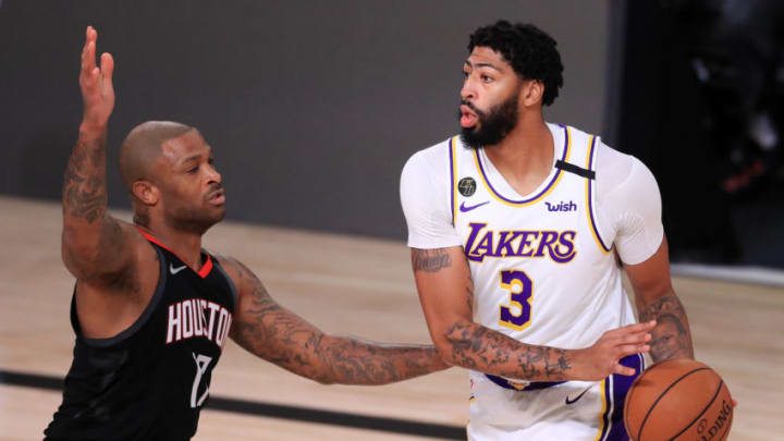 Anthony Davis #3 of the Los Angeles Lakers drives the ball against P.J. Tucker #17 of the Houston Rockets (Photo by Michael Reaves/Getty Images)