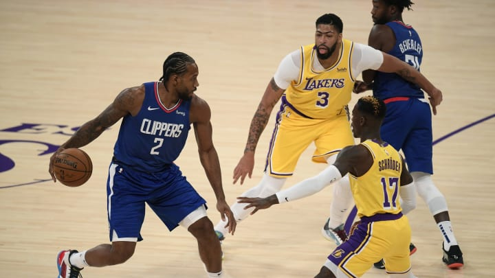 Kawhi Leonard #2 of the LA Clippers, Anthony Davis #3 and Dennis Schroder #17 of the Los Angeles Lakers (Photo by Harry How/Getty Images)