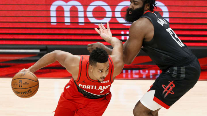 CJ McCollum #3 of the Portland Trail Blazers dribbles past James Harden #13 of the Houston Rockets (Photo by Steph Chambers/Getty Images)