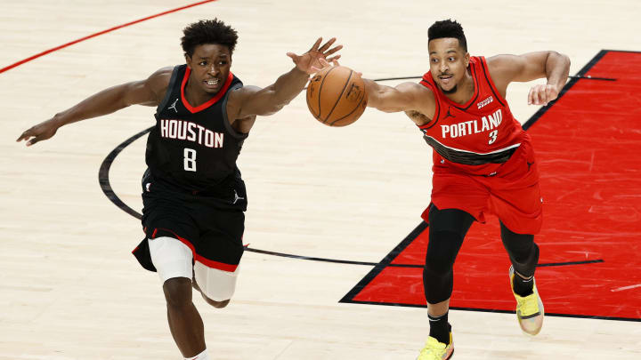 Jae'Sean Tate #8 of the Houston Rockets and CJ McCollum #3 of the Portland Trail Blazers (Photo by Steph Chambers/Getty Images)