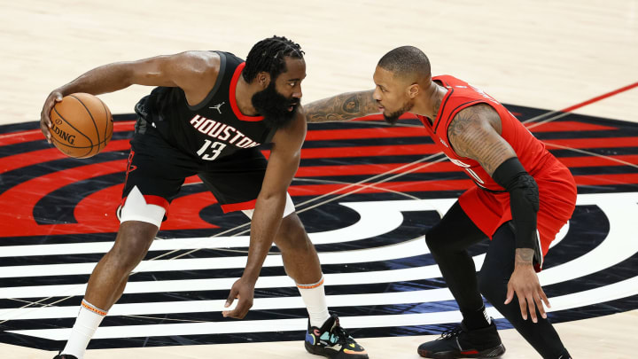 James Harden #13 of the Houston Rockets and Damian Lillard #0 of the Portland Trail Blazers (Photo by Steph Chambers/Getty Images)