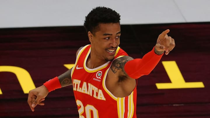 ATLANTA, GEORGIA - DECEMBER 28: John Collins #20 of the Atlanta Hawks reacts after a basket against the Detroit Pistons during the second half at State Farm Arena on December 28, 2020 in Atlanta, Georgia. NOTE TO USER: User expressly acknowledges and agrees that, by downloading and or using this photograph, User is consenting to the terms and conditions of the Getty Images License Agreement. (Photo by Kevin C. Cox/Getty Images)