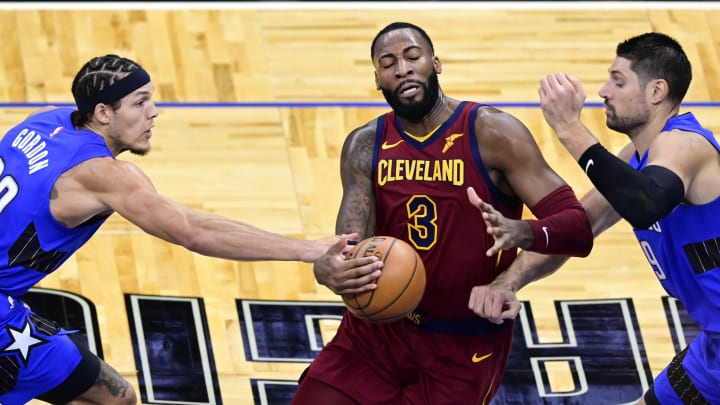 Andre Drummond #3 of the Cleveland Cavaliers drives with the ball as Nikola Vucevic #9 and Aaron Gordon #00 of the Orlando Magic defend (Photo by Douglas P. DeFelice/Getty Images)
