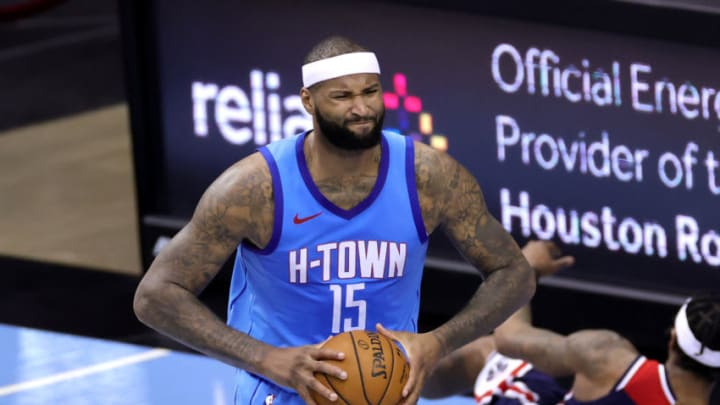 DeMarcus Cousins #15 of the Houston Rockets reacts after grabbing an offensive rebound during the third quarter of a game against the Washington Wizards at Toyota Center on January 26, 2021 in Houston, Texas. NOTE TO USER: User expressly acknowledges and agrees that, by downloading and or using this photograph, User is consenting to the terms and conditions of the Getty Images License Agreement. (Photo by Carmen Mandato/Getty Images)