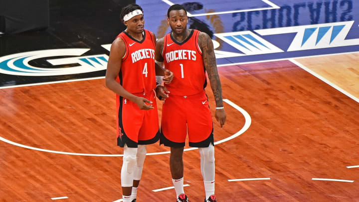 Danuel House Jr. #4 and John Wall #1 of the Houston Rockets (Photo by Justin Ford/Getty Images)