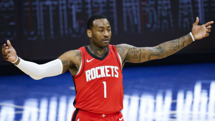 PHILADELPHIA, PENNSYLVANIA - FEBRUARY 17: John Wall #1 of the Houston Rockets reacts to a call during the fourth quarter against the Philadelphia 76ers at Wells Fargo Center on February 17, 2021 in Philadelphia, Pennsylvania. NOTE TO USER: User expressly acknowledges and agrees that, by downloading and or using this photograph, User is consenting to the terms and conditions of the Getty Images License Agreement. (Photo by Tim Nwachukwu/Getty Images)