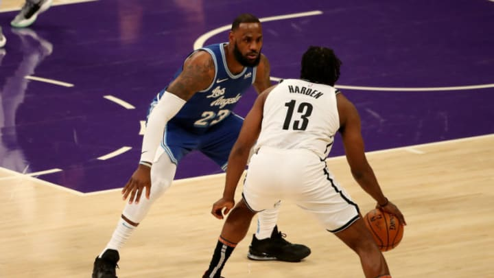 LOS ANGELES, CALIFORNIA - FEBRUARY 18: James Harden #13 of the Brooklyn Nets dribbles the ball against LeBron James #23 of the Los Angeles Lakers during the first quarter at Staples Center on February 18, 2021 in Los Angeles, California. NOTE TO USER: User expressly acknowledges and agrees that, by downloading and or using this photograph, User is consenting to the terms and conditions of the Getty Images License Agreement. (Photo by Katelyn Mulcahy/Getty Images)