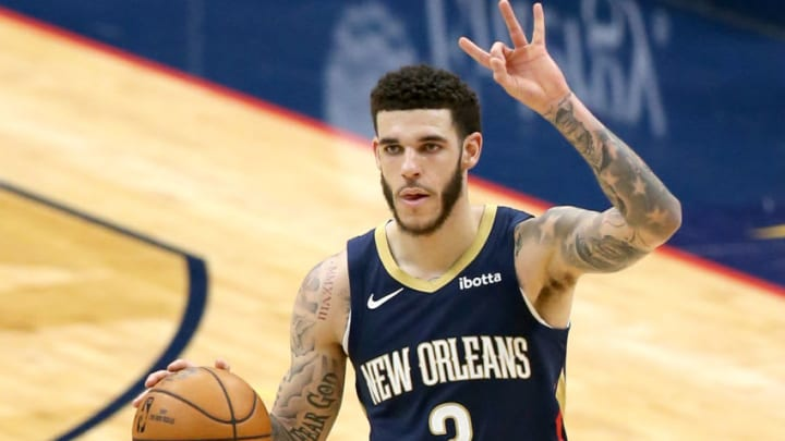 NEW ORLEANS, LOUISIANA - FEBRUARY 17: Lonzo Ball #2 of the New Orleans Pelicans dribbles the ball down court during the third quarter of an NBA game against the Portland Trail Blazers at Smoothie King Center on February 17, 2021 in New Orleans, Louisiana. NOTE TO USER: User expressly acknowledges and agrees that, by downloading and or using this photograph, User is consenting to the terms and conditions of the Getty Images License Agreement. (Photo by Sean Gardner/Getty Images)