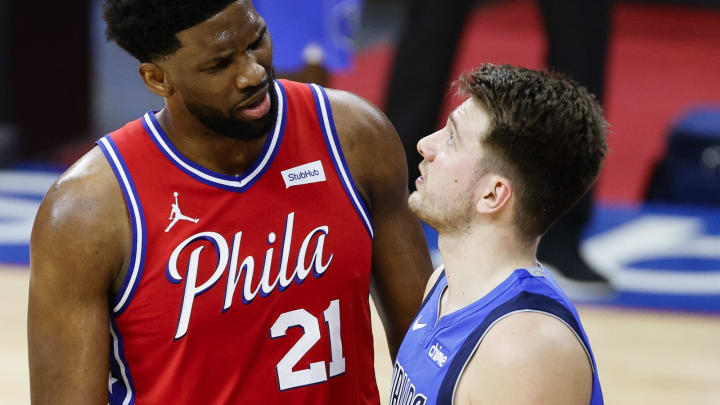 Joel Embiid #21 of the Philadelphia 76ers, Luka Doncic #77 of the Dallas Mavericks (Photo by Tim Nwachukwu/Getty Images)