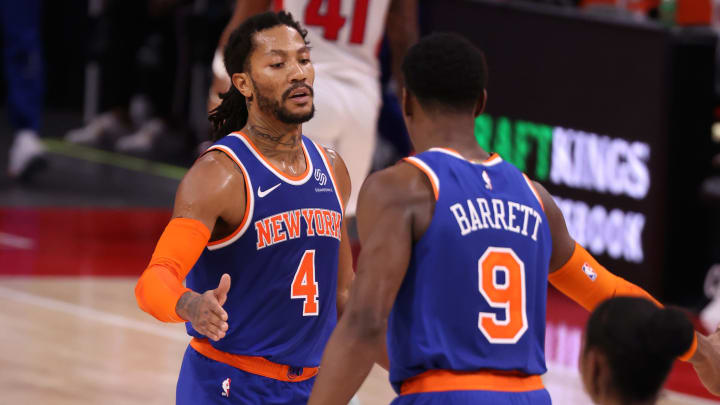 Derrick Rose #4 of the New York Knicks celebrates with RJ Barrett #9 (Photo by Gregory Shamus/Getty Images)