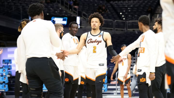 INDIANAPOLIS, INDIANA - MARCH 21: Cade Cunningham #2 of the Oklahoma State Cowboys is welcomed on court before playing the Oregon State Beavers in the second round game of the 2021 NCAA Men's Basketball Tournament at Hinkle Fieldhouse on March 21, 2021 in Indianapolis, Indiana. (Photo by Andy Lyons/Getty Images)