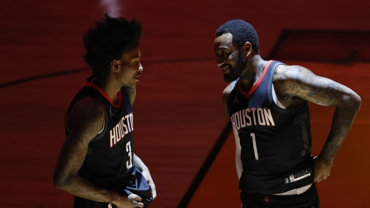 MIAMI, FLORIDA – APRIL 19: Kevin Porter Jr. #3 and John Wall #1 of the Houston Rockets (Photo by Michael Reaves/Getty Images)