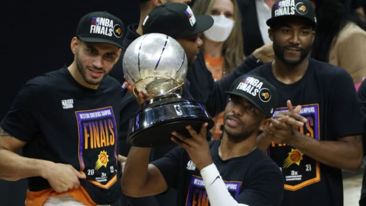 LOS ANGELES, CALIFORNIA - JUNE 30: Chris Paul #3 of the Phoenix Suns holds the Western Conference Championship trophy after the Suns defeated the LA Clippers in Game Six of the Western Conference Finals at Staples Center on June 30, 2021 in Los Angeles, California. NOTE TO USER: User expressly acknowledges and agrees that, by downloading and or using this photograph, User is consenting to the terms and conditions of the Getty Images License Agreement. (Photo by Harry How/Getty Images)