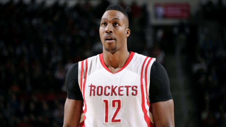 HOUSTON, TX - DECEMBER 29: Dwight Howard #12 of the Houston Rockets stands on the court during a game against the Washington Wizards on December 29, 2014 at Toyota Center in Houston, Texas. NOTE TO USER: User expressly acknowledges and agrees that, by downloading and or using this Photograph, user is consenting to the terms and conditions of the Getty Images License Agreement. Mandatory Copyright Notice: Copyright 2014 NBAE (Photo by Bill Baptist/NBAE via Getty Images)