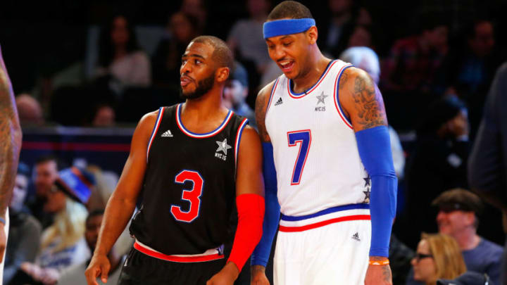 Chris Paul #3 of the Western Conference in action against Carmelo Anthony #7 of the Eastern Conference (Photo by Jim McIsaac/Getty Images)