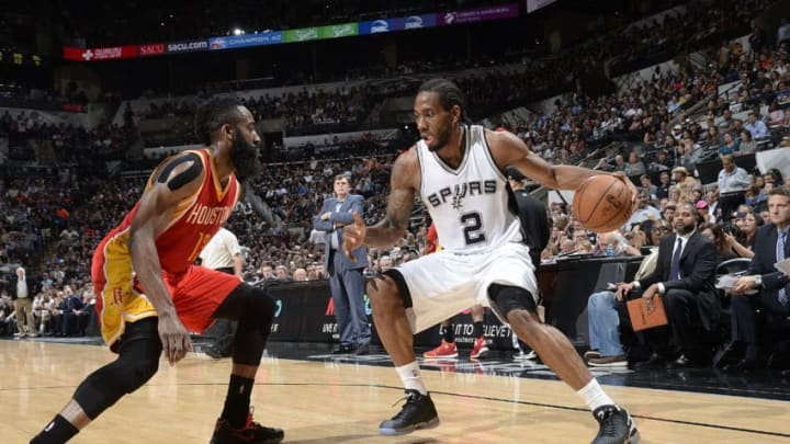 SAN ANTONIO, TX - APRIL 8: Kawhi Leonard #2 of the San Antonio Spurs handles the ball against James Harden #13 of the Houston Rockets on April 8, 2015 at the AT&T Center in San Antonio, Texas. NOTE TO USER: User expressly acknowledges and agrees that, by downloading and or using this photograph, user is consenting to the terms and conditions of the Getty Images License Agreement. Mandatory Copyright Notice: Copyright 2015 NBAE (Photos by D. Clarke Evans/NBAE via Getty Images)