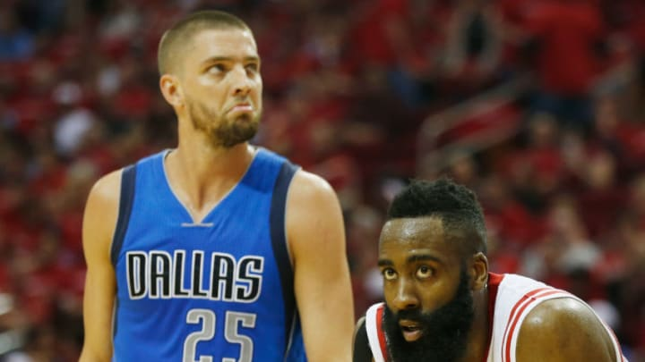 HOUSTON, TX - APRIL 18: James Harden #13 of the Houston Rockets waits on the court with Chandler Parsons #25 of the Dallas Mavericks during Game One in the Western Conference Quarterfinals of the 2015 NBA Playoffs on April 18, 2015 at the Toyota Center in Houston, Texas. NOTE TO USER: User expressly acknowledges and agrees that, by downloading and/or using this photograph, user is consenting to the terms and conditions of the Getty Images License Agreement. (Photo by Scott Halleran/Getty Images)