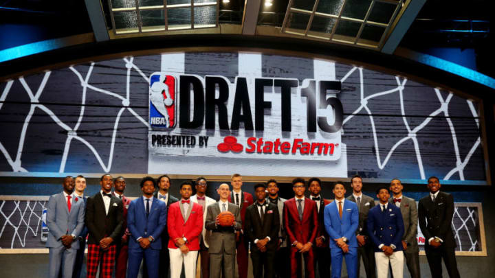 NEW YORK, NY - JUNE 25: Commissioner Adam Silver poses for a photo with top prospects before the start of the First Round of the 2015 NBA Draft at the Barclays Center on June 25, 2015 in the Brooklyn borough of New York City. NOTE TO USER: User expressly acknowledges and agrees that, by downloading and or using this photograph, User is consenting to the terms and conditions of the Getty Images License Agreement. (Photo by Elsa/Getty Images)