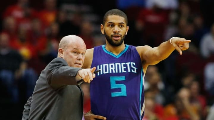HOUSTON, TX - DECEMBER 21: Head coach Steve Clifford and Nicolas Batum #5 of the Charlotte Hornets watch the action on the court during their game against the Houston Rockets at Toyota Center on December 21, 2015 in Houston, Texas. NOTE TO USER: User expressly acknowledges and agrees that, by downloading and or using this Photograph, user is consenting to the terms and conditions of the Getty Images License Agreement. (Photo by Scott Halleran/Getty Images)