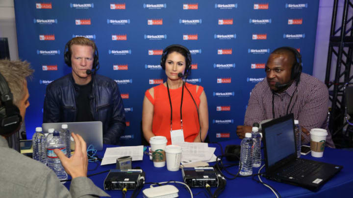 SAN FRANCISCO, CA - FEBRUARY 05: (L-R) SiriusXM host Ric Bucher, sportscaster Nicole Zaloumis and former NFL player Kirk Morrison host at the SiriusXM set at Super Bowl 50 Radio Row at the Moscone Center on February 5, 2016 in San Francisco, California. (Photo by Cindy Ord/Getty Images for SiriusXM)