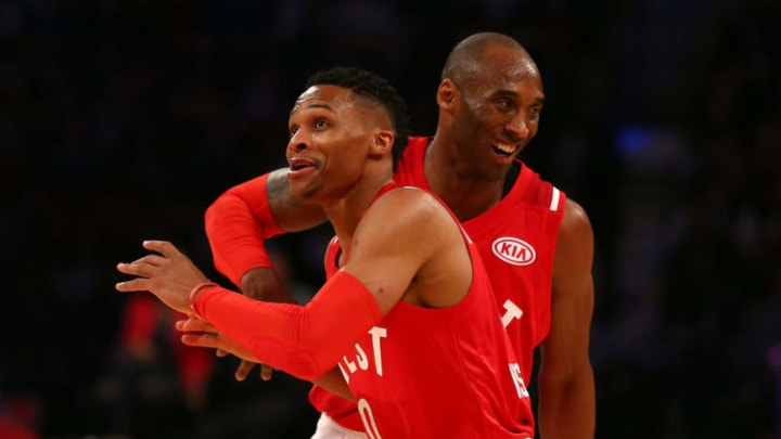 TORONTO, ON - FEBRUARY 14: Russell Westbrook #0 of the Oklahoma City Thunder and the Western Conference and Kobe Bryant #24 of the Los Angeles Lakers and the Western Conference react after a play in the second half against the Eastern Conference during the NBA All-Star Game 2016 at the Air Canada Centre on February 14, 2016 in Toronto, Ontario. NOTE TO USER: User expressly acknowledges and agrees that, by downloading and/or using this Photograph, user is consenting to the terms and conditions of the Getty Images License Agreement. (Photo by Elsa/Getty Images)