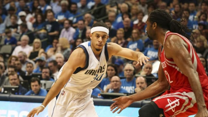 The Dallas Mavericks' Seth Curry (30) puts the ball on the floor against the Houston Rockets' Nene Hilario (42) at American Airlines Center in Dallas on Friday, Oct. 28, 2016. The Rockets won, 106-98. (Richard W. Rodriguez/Fort Worth Star-Telegram/TNS via Getty Images)