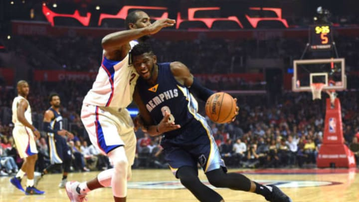 LOS ANGELES, CA – NOVEMBER 16: James Ennis #8 of the Memphis Grizzlies drives to the basket on Luc Mbah a Moute #12 of the LA Clippers during the first half at Staples Center on November 16, 2016 in Los Angeles, California. (Photo by Harry How/Getty Images)