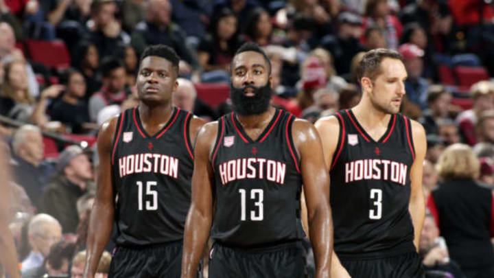PORTLAND, OR – NOVEMBER 27: James Harden #13, Clint Capela #15 and Ryan Anderson #3 of the Houston Rockets look on during the game against the Portland Trail Blazers on November 27, 2016 at the Moda Center in Portland, Oregon. (Photo by Cameron Browne/NBAE via Getty Images)