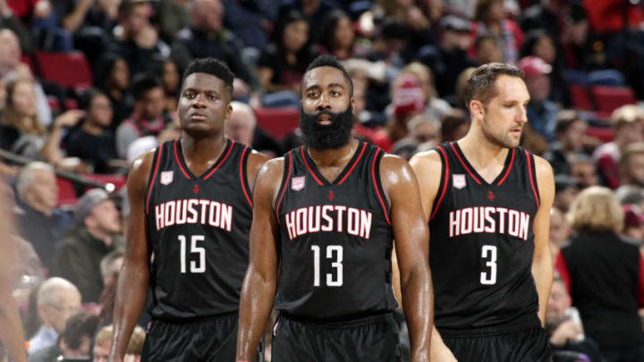 PORTLAND, OR - NOVEMBER 27: James Harden #13, Clint Capela #15 and Ryan Anderson #3 of the Houston Rockets look on during the game against the Portland Trail Blazers on November 27, 2016 at the Moda Center in Portland, Oregon. (Photo by Cameron Browne/NBAE via Getty Images)