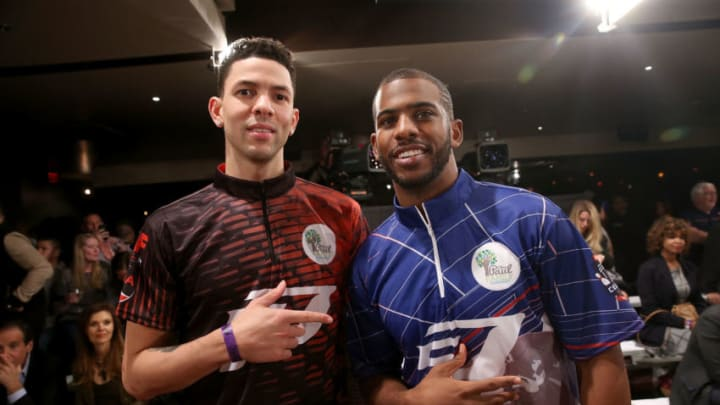 Professional basketbal players Austin Rivers and Chris Paul (Photo by Jesse Grant/Getty Images for Professional Bowlers Association)