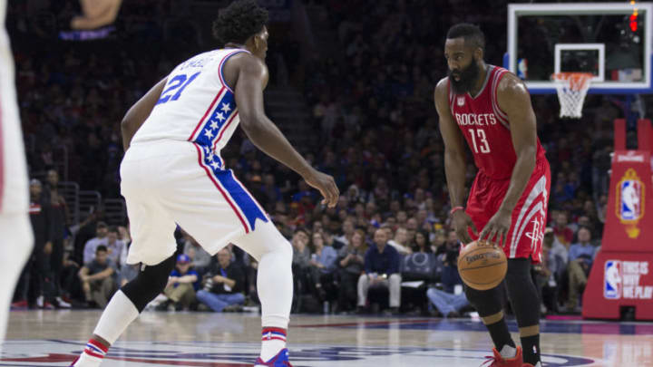 PHILADELPHIA, PA - JANUARY 27: James Harden #13 of the Houston Rockets dribbles the ball against Joel Embiid #21 of the Philadelphia 76ers in the third quarter at the Wells Fargo Center on January 27, 2017 in Philadelphia, Pennsylvania. The Rockets defeated the 76ers 123-118. NOTE TO USER: User expressly acknowledges and agrees that, by downloading and or using this photograph, User is consenting to the terms and conditions of the Getty Images License Agreement. (Photo by Mitchell Leff/Getty Images)