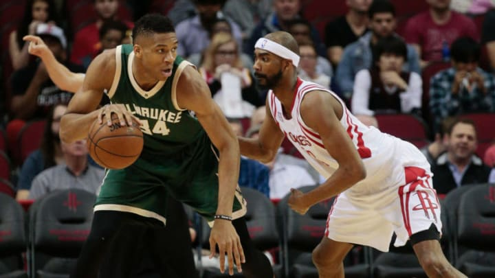 Giannis Antetokounmpo #34 of the Milwaukee Bucks backs in on Corey Brewer #33 of the Houston Rockets. (Photo by Bob Levey/Getty Images)