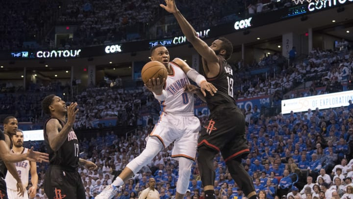 OKLAHOMA CITY, OK – APRIL 21: Russell Westbrook #0 of the Oklahoma City Thunder drives around James Harden #13 of the Houston Rockets for two points during the second half of Game Three in the 2017 NBA Playoffs Western Conference Quarterfinals on April 21, 2017 in Oklahoma City, Oklahoma. Oklahoma City defeated Houston 115-113 NOTE TO USER: User expressly acknowledges and agrees that, by downloading and or using this photograph, User is consenting to the terms and conditions of the Getty Images License Agreement. (Photo by J Pat Carter/Getty Images)
