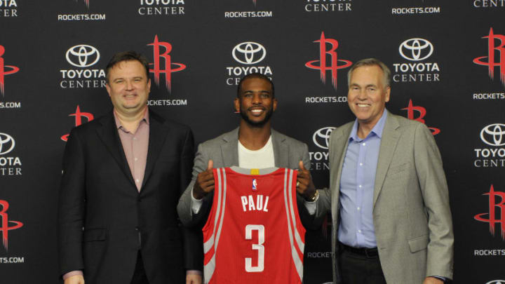 HOUSTON, TX - JULY 14: General Manager Daryl Morey of the Houston Rockets, Chris Paul and Head Coach Mike D'Antoni poses for a photo during a press conference on July 14, 2017 at the Toyota Center in Houston, Texas. NOTE TO USER: User expressly acknowledges and agrees that, by downloading and/or using this photograph, user is consenting to the terms and conditions of the Getty Images License Agreement. Mandatory Copyright Notice: Copyright 2017 NBAE (Photo by Bill Baptist/NBAE via Getty Images)
