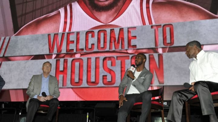 HOUSTON, TX - JULY 14: The Houston Rockets introduce Chris Paul and chats with Calvin Murphy on July 14, 2017 at the Toyota Center in Houston, Texas. NOTE TO USER: User expressly acknowledges and agrees that, by downloading and/or using this photograph, user is consenting to the terms and conditions of the Getty Images License Agreement. Mandatory Copyright Notice: Copyright 2017 NBAE (Photo by Bill Baptist/NBAE via Getty Images)