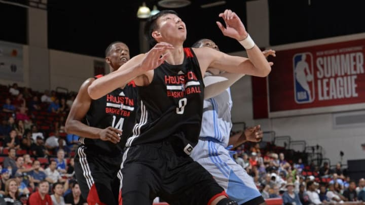 LAS VEGAS, NV - JULY 7: Zhou Qi #9 of the Houston Rockets looks to rebound in a game against the Denver Nuggets during the 2017 Las Vegas Summer League on July 7, 2017 at the Cox Pavilion in Las Vegas, Nevada. NOTE TO USER: User expressly acknowledges and agrees that, by downloading and or using this Photograph, user is consenting to the terms and conditions of the Getty Images License Agreement. Mandatory Copyright Notice: Copyright 2017 NBAE (Photo by David Dow/NBAE via Getty Images)