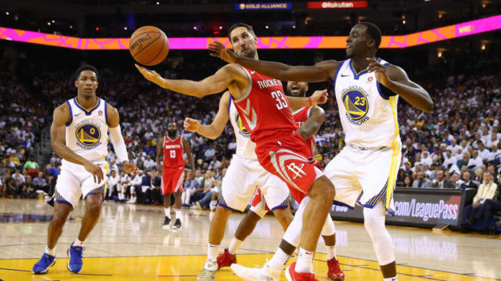 OAKLAND, CA - OCTOBER 17: Ryan Anderson #33 of the Houston Rockets and Draymond Green #23 of the Golden State Warriors go for the ball during their NBA game at ORACLE Arena on October 17, 2017 in Oakland, California. NOTE TO USER: User expressly acknowledges and agrees that, by downloading and or using this photograph, User is consenting to the terms and conditions of the Getty Images License Agreement. (Photo by Ezra Shaw/Getty Images)