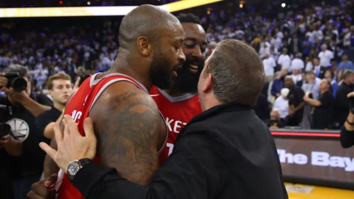 PJ Tucker #4, James Harden #13 and team owner Tilman Fertitta of the Houston Rockets (Photo by Ezra Shaw/Getty Images)
