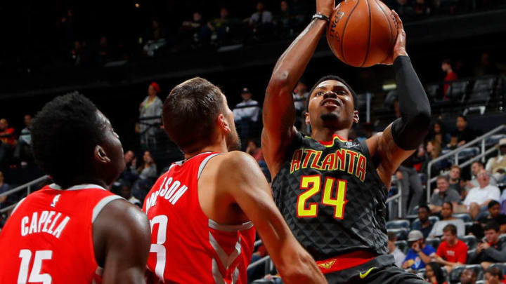 ATLANTA, GA - NOVEMBER 03: Kent Bazemore #24 of the Atlanta Hawks drives against Clint Capela #15 and Ryan Anderson #33 of the Houston Rockets at Philips Arena on November 3, 2017 in Atlanta, Georgia. NOTE TO USER: User expressly acknowledges and agrees that, by downloading and or using this photograph, User is consenting to the terms and conditions of the Getty Images License Agreement. (Photo by Kevin C. Cox/Getty Images)