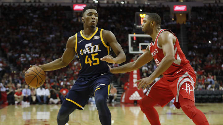 Donovan Mitchell #45 of the Utah Jazz controls the ball defended by Eric Gordon #10 of the Houston Rockets (Photo by Tim Warner/Getty Images)